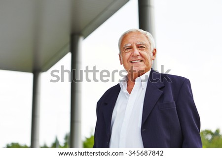 Happy old senior business man smiling outdoors - stock photo