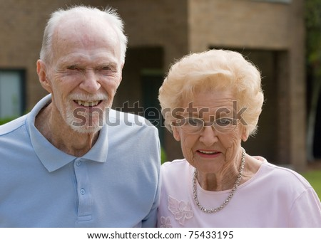 Happy old senior couple outside during the day - stock photo