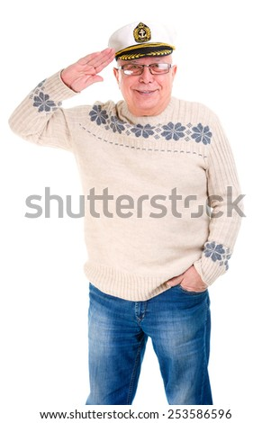 Happy old senior man smiling and saluting with a boat captain cap. Isolated - stock photo