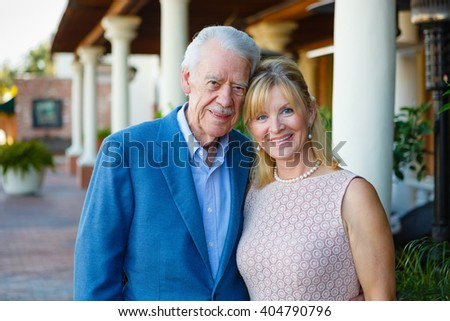 Happy old senior mature couple in town. summer evening time - stock photo