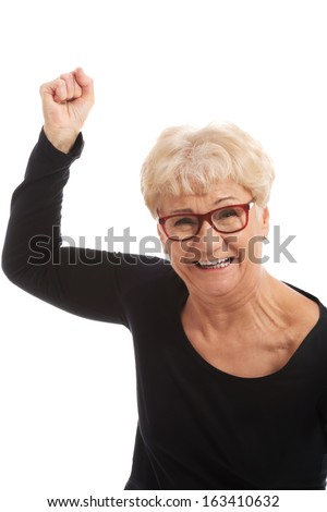 Happy old woman having closed fists. Isolated on white.