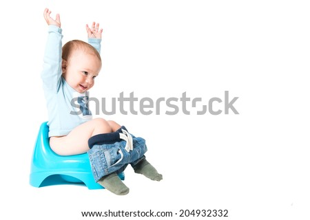 Happy one year old boy having fun on chamber pot, isolated over white background  - stock photo