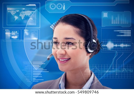 Happy operator posing with a headset against black and grey interface