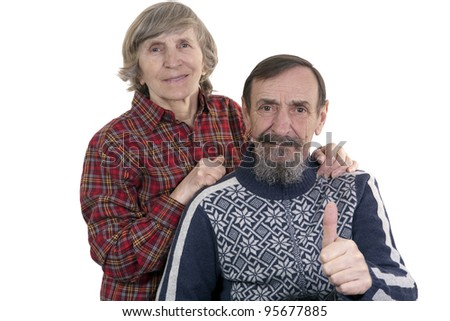 happy over sixty retired couple posing on white background