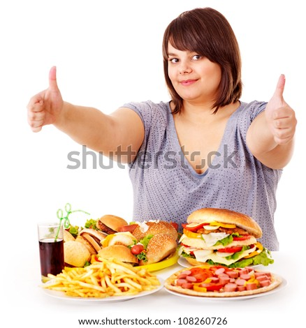 Happy overweight woman eating fast food. - stock photo