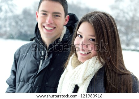 Happy pair loving each other in beautiful winter day