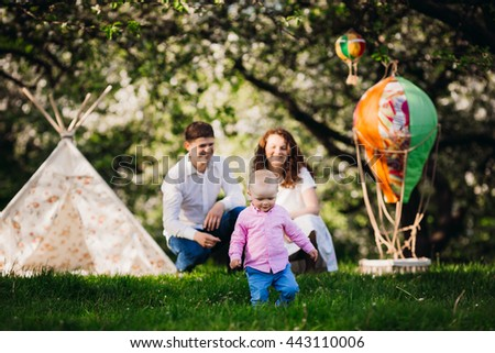 Happy parents and a baby - stock photo