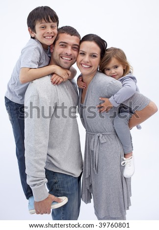 Happy parents giving children piggyback rides at home - stock photo