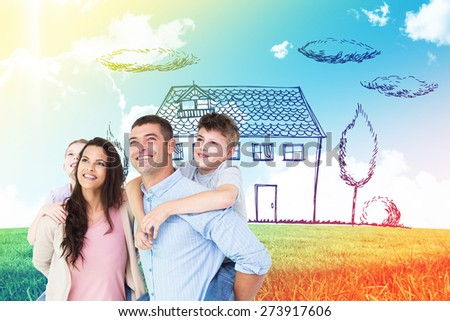 Happy parents giving piggyback ride to children while looking up against blue sky over green field - stock photo