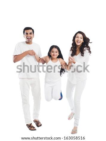 Happy parents playing with their daughter - stock photo