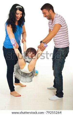 Happy parents playing with their daughter home and having fun together - stock photo