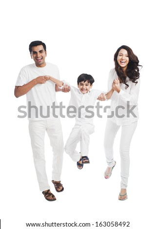 Happy parents playing with their son - stock photo