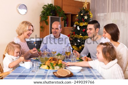 happy parents with adult kids and grandchildren celebrating xmas - stock photo