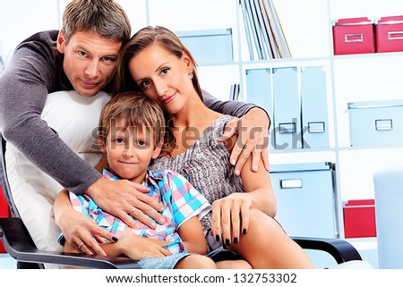 Happy parents with their son together at home. - stock photo
