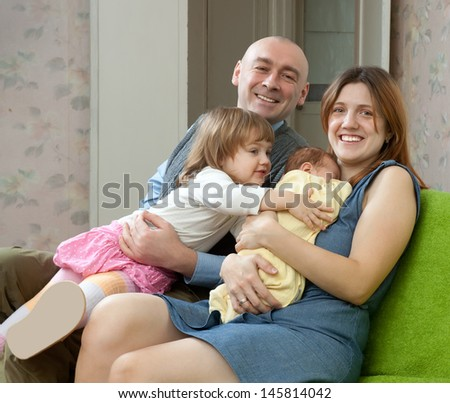 Happy parents with two children  at home   - stock photo