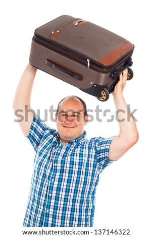 Happy passenger man lifting up his luggage, isolated on white background - stock photo