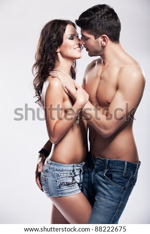 Happy passionate heterosexual couple in studio - stock photo
