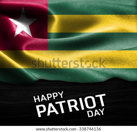 Happy Patriot Day Togo  flag on wood Texture background