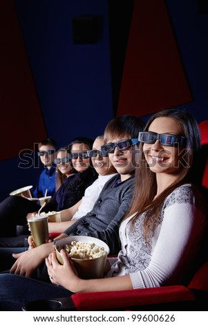Happy people in 3D glasses at the cinema - stock photo