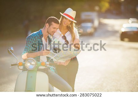 Happy people on a scooter - stock photo