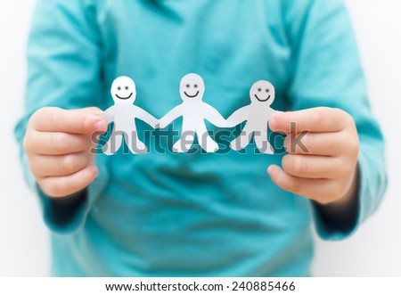 Happy People Paper Chain in children's hands - stock photo