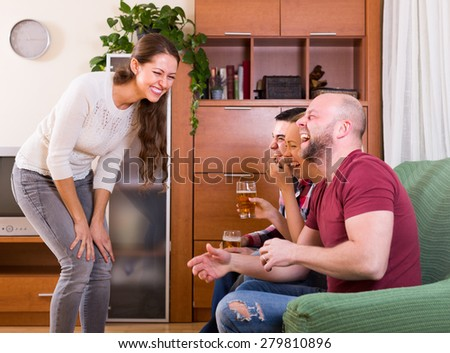 Happy people playing charades indoor and laughing - stock photo