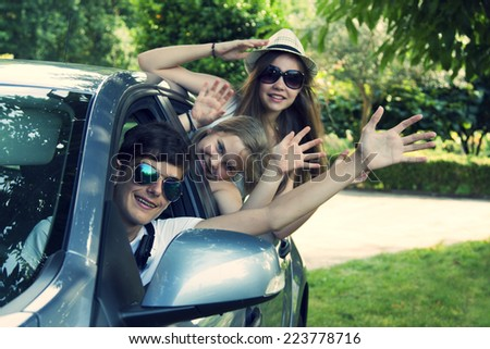 happy people traveling by car, vintage effect - stock photo