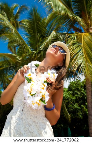 Happy people. Woman with welcoming Lei cheerful, happiness during summer vacation holidays on Hawaii. - stock photo