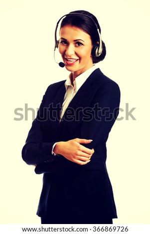 Happy phone operator in headset - stock photo