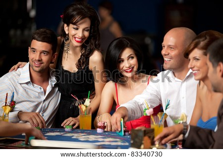 happy player and friends playing blackjack - stock photo