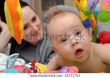 Happy playful baby with mummy