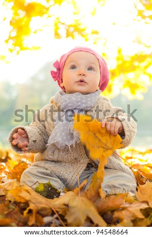 happy playful child outdoors - stock photo