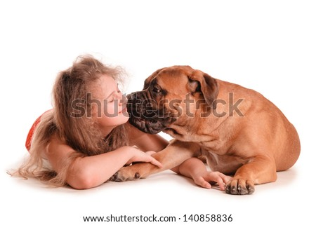 happy playful teenage girl and a dog bullmastiff. isolated on white background