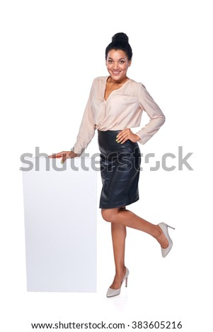 Happy playful woman standing leaning at blank white banner in full length, over white background - stock photo