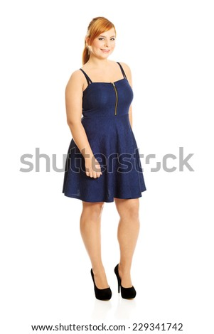 Happy plus size woman posing in skirt - stock photo