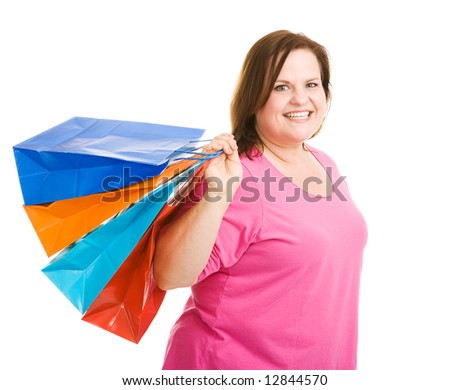 Happy plus sized model holding shopping bags.  Isolated on white.