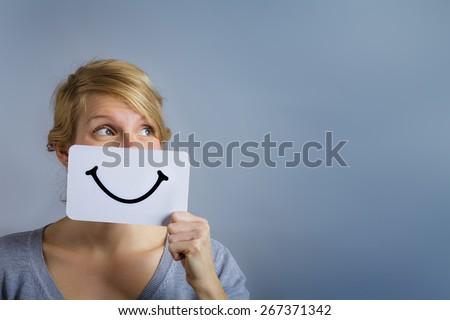 Happy Portrait of a Woman Holding a Smiling Mood Board - stock photo