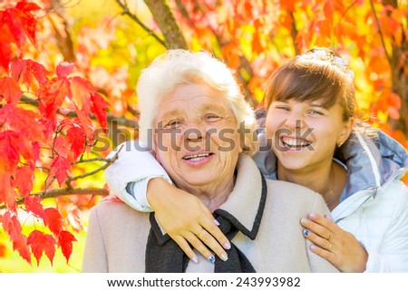 Happy portrait of grandmother and granddaughter - stock photo