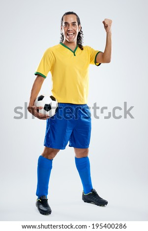 Happy portrait of smiling brasil football soccer player for brazil world cup