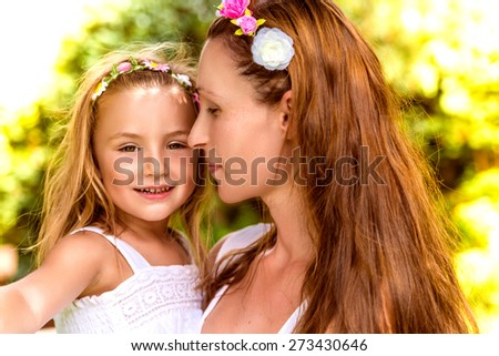 happy portrait with blurred sunlit background - stock photo