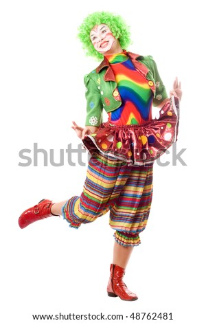 Happy posing female clown. Isolated on white