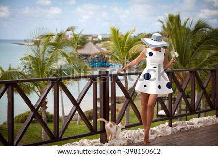 Happy positive summer portrait of cute sexy woman in summer dress on exitic resort. Free happy girl at summer luxury vacation, happy time.