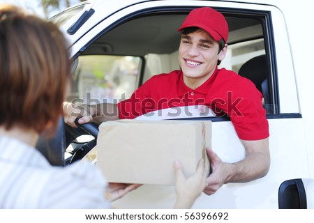 happy postal delivery courier in a van delivering package - stock photo
