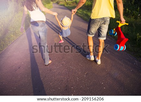 Happy pregnant family having fun during the walk - stock photo