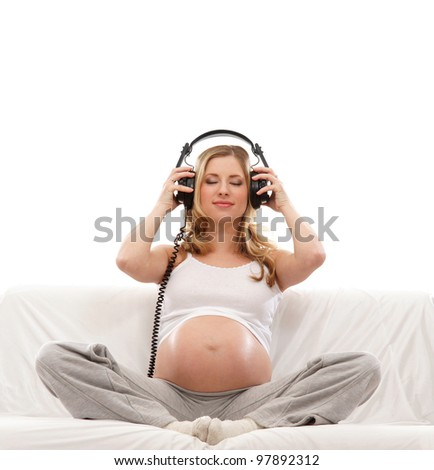 Happy pregnant girl isolated on white - stock photo