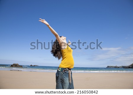 happy pregnant woman at beach - stock photo