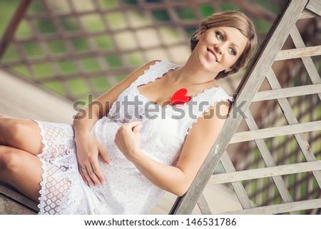 Happy pregnant woman  on lake - stock photo