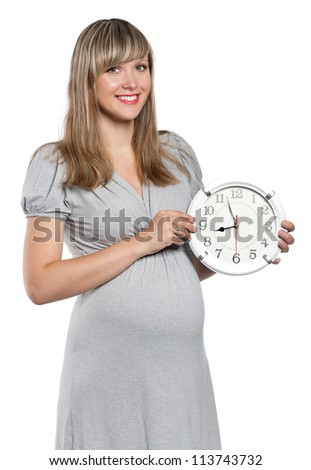Happy pregnant woman with clock isolated on white background - stock photo