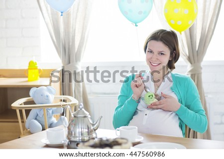 Happy pregnant woman with ice cream smiling