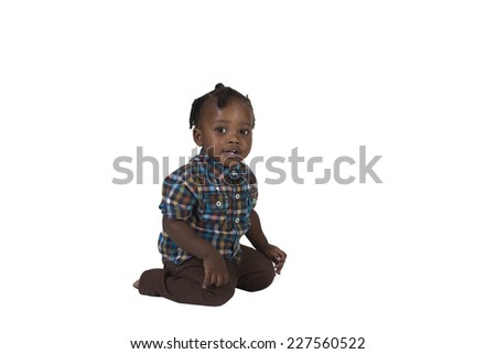 Happy preschool toddler isolated on a white background